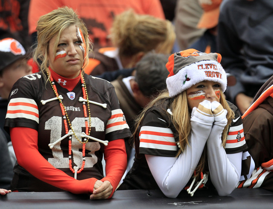 Photo -   Cleveland Browns fans reacts in the fourth quarter of an NFL football game against the Buffalo Bills, Sunday, Sept. 23, 2012, in Cleveland. (AP Photo/Tony Dejak)