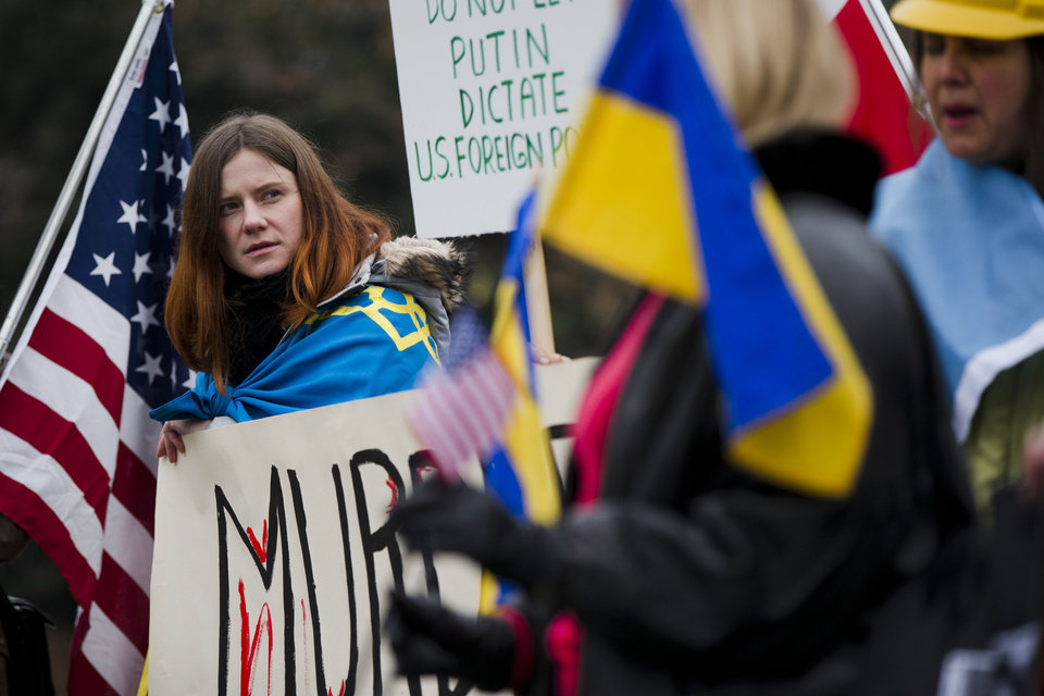 Photo - Yulia Kurka and others with the Ukrainian American and Polish American communities demonstrate in support Ukrainian anti-government protesters outside Independence Hall, Wednesday, Feb. 19, 2014, in Philadelphia. The violence on Tuesday was the worst in nearly three months of anti-government protests that have paralyzed Ukraine's capital, Kiev, in a struggle over the identity of a nation divided in loyalties between Russia and the West, and the worst in the country's post-Soviet history. (AP Photo/Matt Rourke)