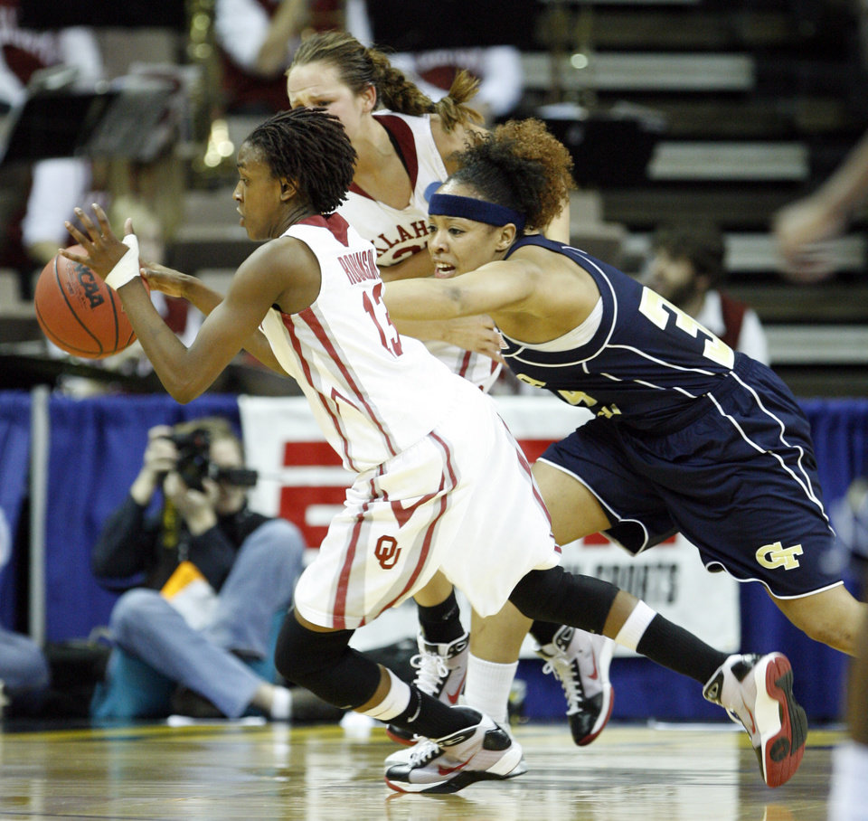 Photo - Danielle Robinson steels the ball from Iasia Heminway in the first half as the University of Oklahoma (OU) plays Georgia Tech in round two of the 2009 NCAA Division I Women's Basketball Tournament at Carver-Hawkeye Arena at the University of Iowa in Iowa City, IA on Tuesday, March 24, 2009. 