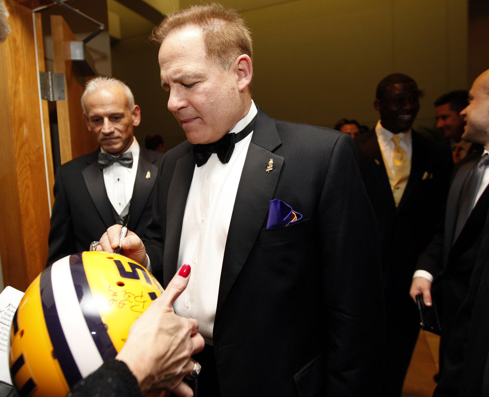 Photo - LSU coach Les Miles signs an autograph before the Jim Thorpe Awards at the National Cowboy & Western Heritage in Oklahoma City, Tuesday, Feb. 7, 2012. Photo by Sarah Phipps, The Oklahoman