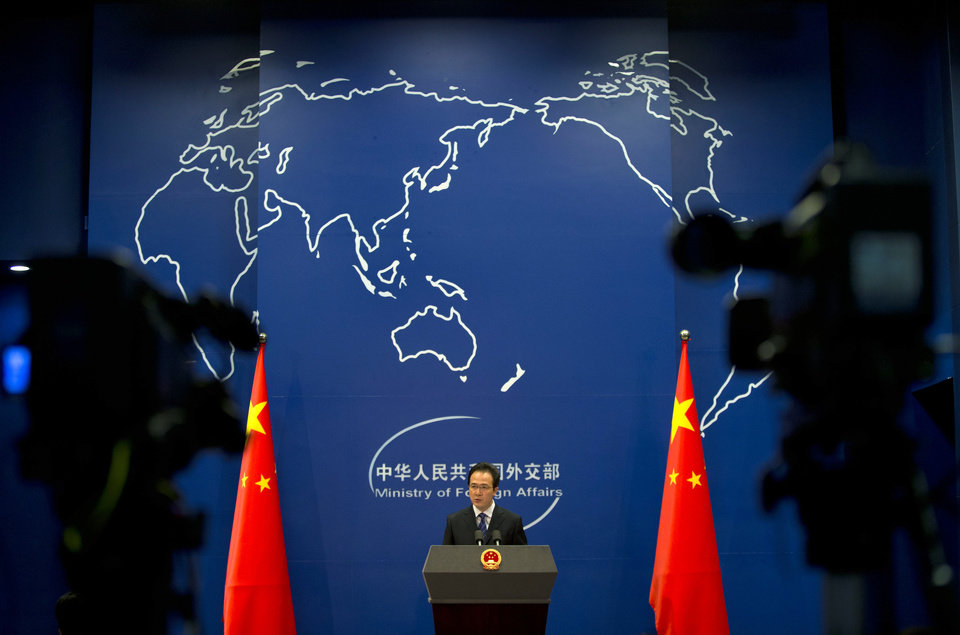 Photo - Foreign ministry spokesman Hong Lei speaks during a daily briefing at the Ministry of Foreign Affairs office in Beijing, China Tuesday, May 20, 2014. China on Tuesday warned the United States was jeopardizing military ties by charging five Chinese officers with cyberspying and tried to turn the tables on Washington by calling it