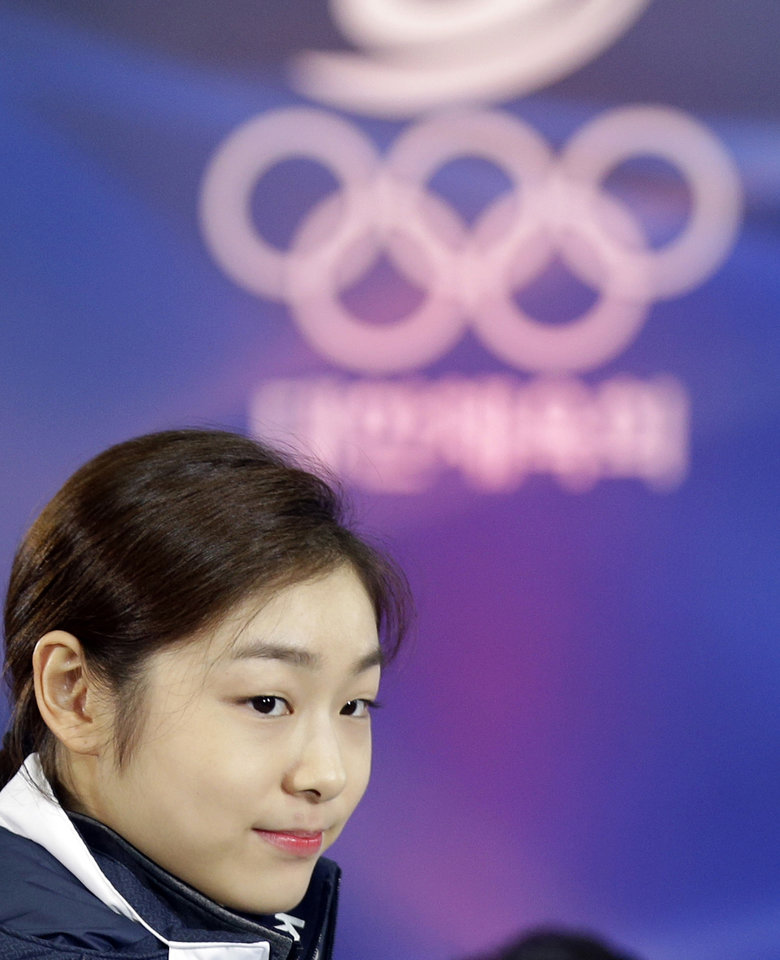 Photo - South Korean Kim Yuna, Vancouver gold medalist for the women's figure skating, attends the inaugural ceremony of the South Korean team for the Sochi Winter Olympics in Seoul, South Korea, Thursday, Jan. 23, 2014. South Korea will send 64 athletes to Sochi which will be held from Feb. 7-23. (AP Photo/Lee Jin-man)