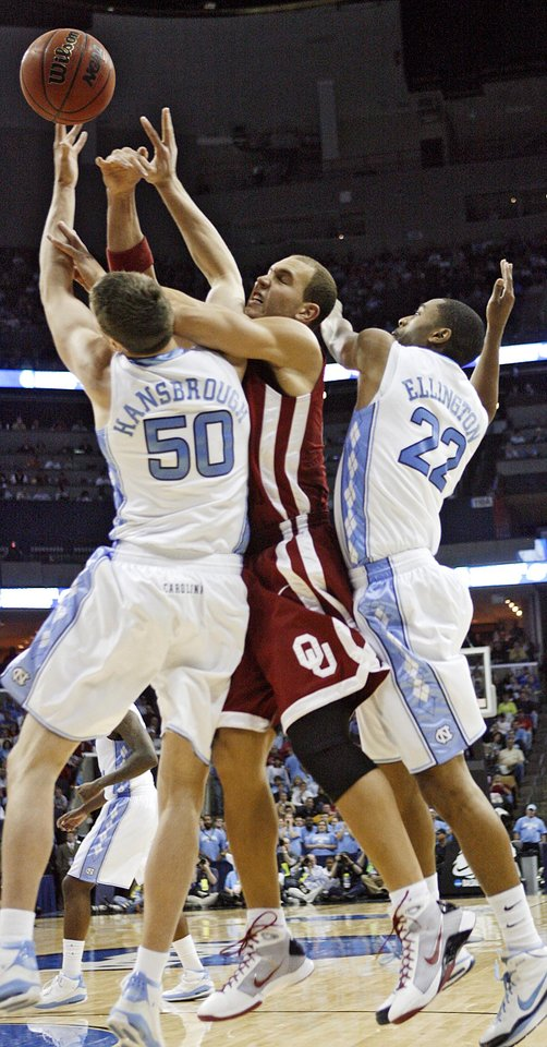 Photo - Oklahoma's Taylor Griffin (32) battles for a rebound with North Carolina's Tyler Hansbrough (50) and Wayne Ellington (22) during the second half in the Elite Eight game of NCAA Men's Basketball Regional between the University of North Carolina and the University of Oklahoma at the FedEx Forum on Sunday, March 29, 2009, in Memphis, Tenn.