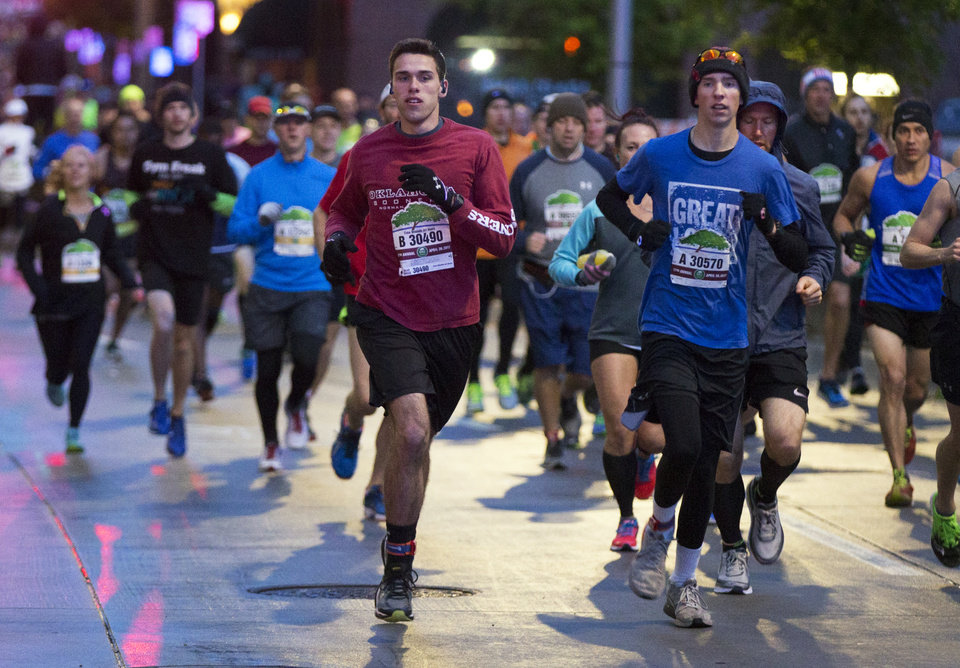 Photo - Runners travel south on N Robinson Ave. near Sheridan at the beginning of the Oklahoma City Memorial Marathon in Oklahoma City, Sunday, April 30, 2017. Photo by Nate Billings, The Oklahoman