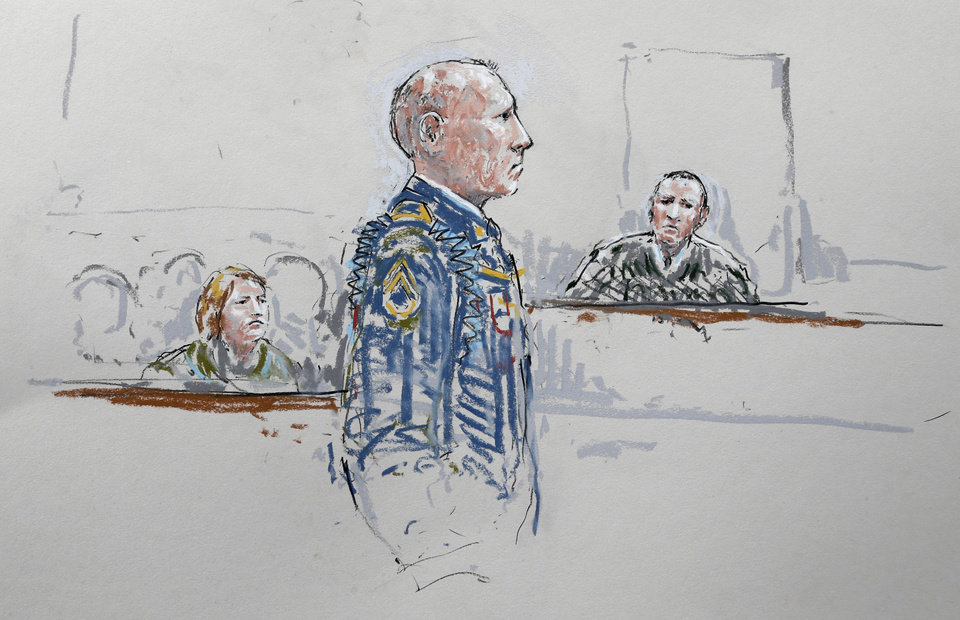 Photo - In this courtroom sketch, U.S. Army Staff Sgt. Robert Bales, center, stands before military judge Col. Jeffery Nance, right,  as Bales' wife Kari Bales looks on at left, Wednesday, June 5, 2013, during a plea hearing in a military courtroom at Joint Base Lewis-McChord in Washington state. Bales pleaded guilty to multiple counts of murder, stemming from a pre-dawn attack on two villages in Kandahar Province in Afghanistan in March, 2012. (AP Photo/Peter Millett)