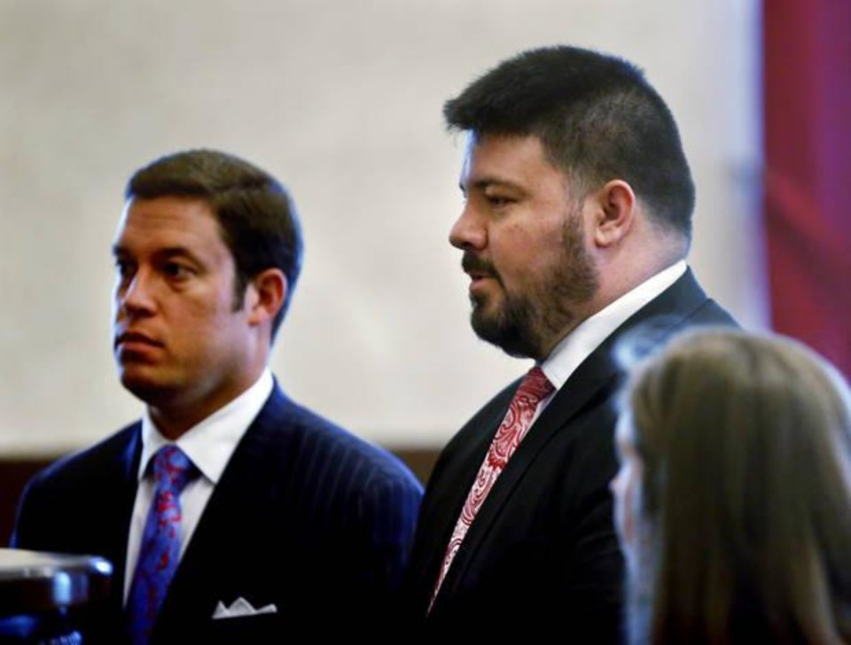 Photo -  Former Sen. Ralph Shortey, right, makes his first court appearance in his child prostitution case. Standing with him is his defense attorney, Ed Blau. [Photo by Steve Sisney, The Oklahoman]