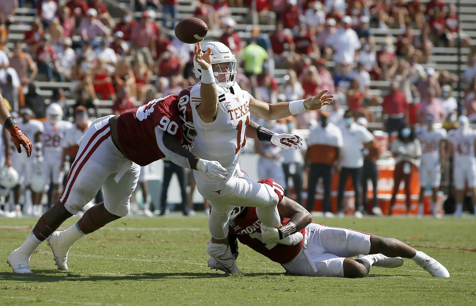 Photo - Oklahoma's Josh Ellison (90) and Nik Bonitto (11) put pressure on Texas' Sam Ehlinger (11) during the Red River Showdown on Saturday at the Cotton Bowl in Dallas. [Bryan Terry/The Oklahoman]