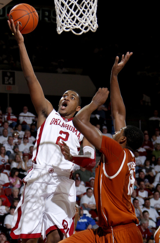 Oklahoma's Steven Pledger (2) goes to the basket around Texas' Tristan Thompson during the NCAA college basketball game between the University of Oklahoma Sooners and Texas Longhorns at Lloyd Noble Center in Norman, Okla., Wednesday, Feb. 9, 2011. Photo by Bryan Terry, The Oklahoman