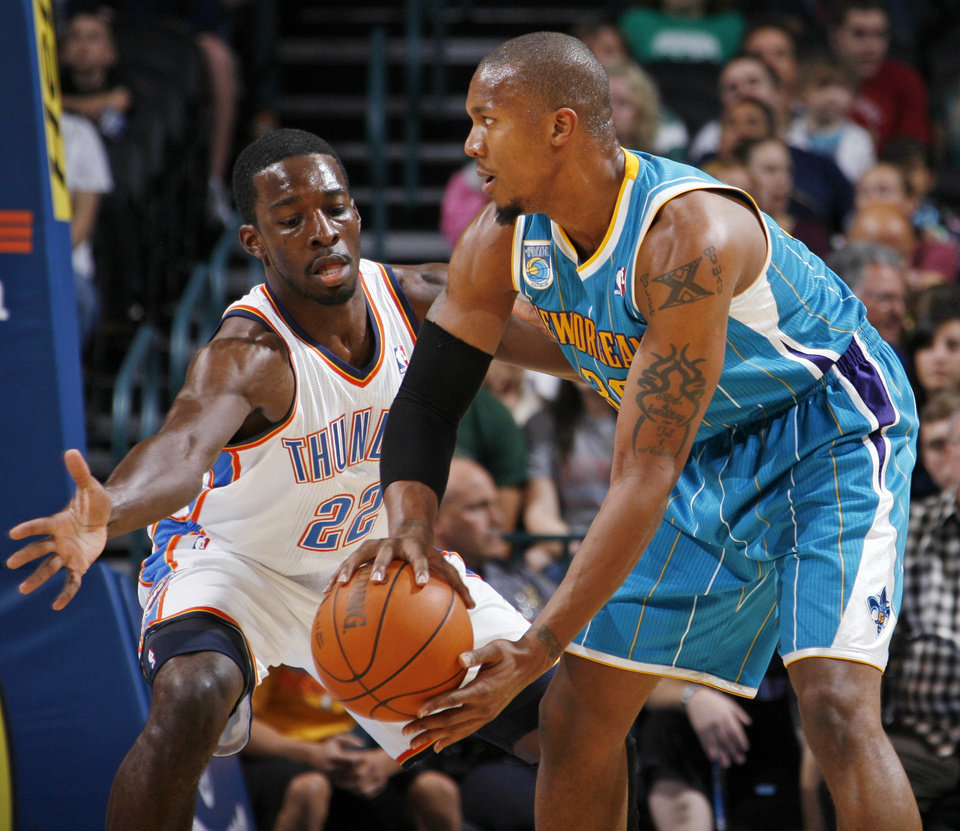 Photo - Oklahoma City's Jeff Green (22) defends David West (30) of New Orleans during the preseason NBA basketball game between the New Orleans Hornets and the Oklahoma City Thunder at the Ford Center in Oklahoma City, Thursday, October 21, 2010. Photo by Nate Billings, The Oklahoman