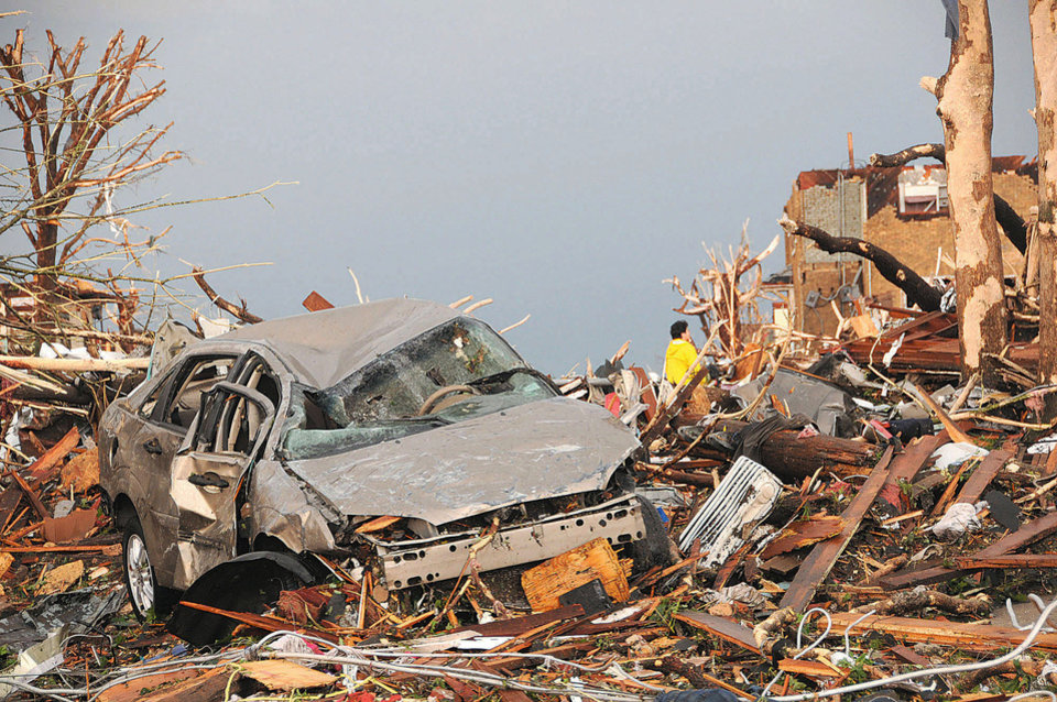 Photo - Vehicles and houses in the vicinity of Twenty-fourth and Main Streets are a jumble of rubble after a the tornado swept through Joplin, Mo., on Sunday evening, May 22, 2011. (AP Photo/The Joplin Globe, Mari Taylor) ORG XMIT: MOJOP101