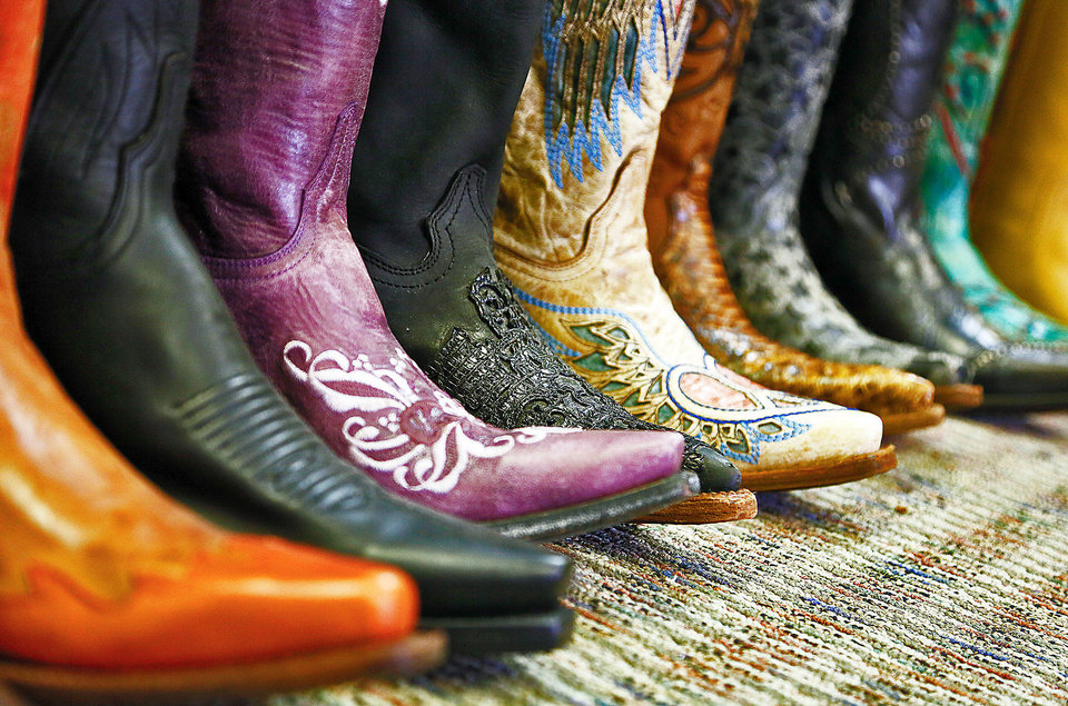 Cowboy boots are among the merchandise Lesta Oliver is selling.
