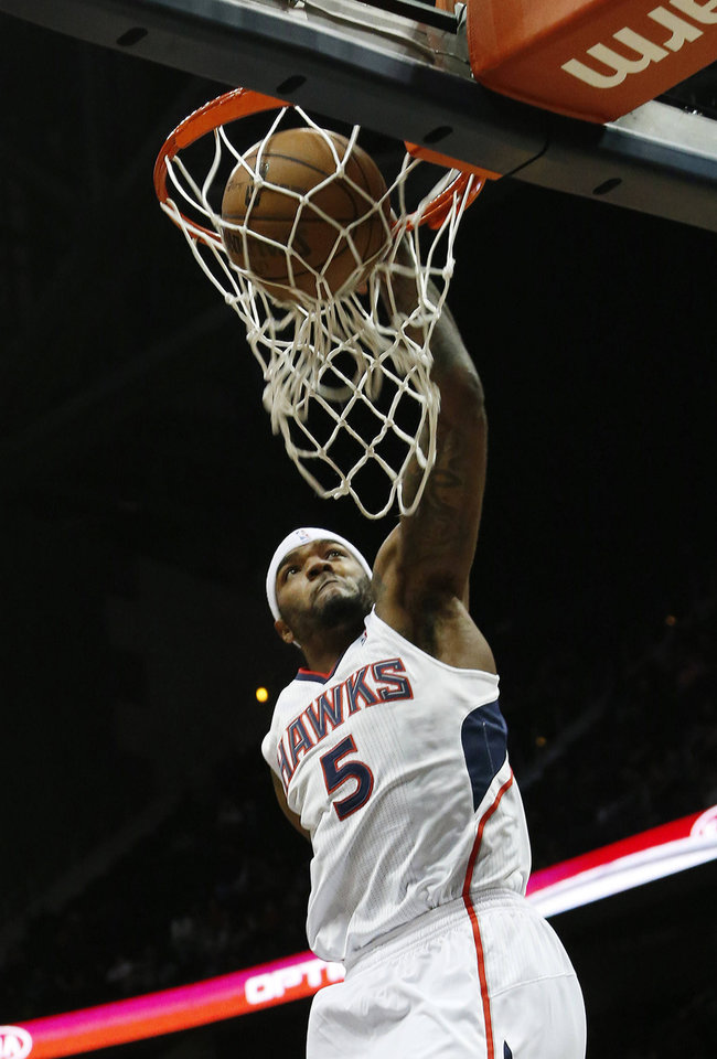 Atlanta Hawks small forward Josh Smith (5) scores in the first half of an NBA basket ball game against the Detroit Pistons, Wednesday, Dec. 26, 2012, in Atlanta. (AP Photo/John Bazemore)