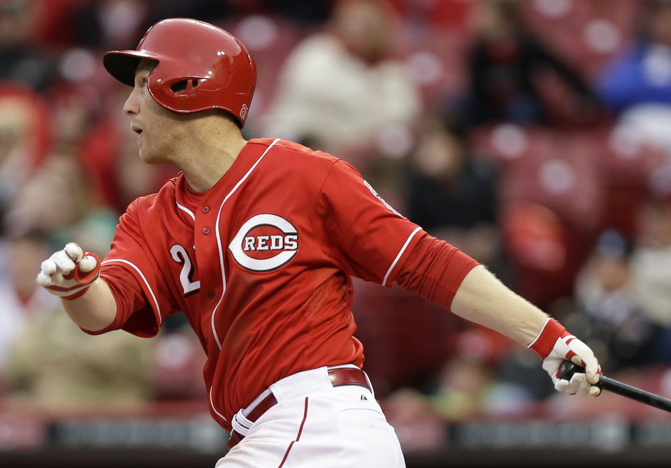Photo - Cincinnati Reds' Todd Frazier hits a three-run home run off St. Louis Cardinals relief pitcher Pat Neshek in the seventh inning of a baseball game on Thursday, April 3, 2014, in Cincinnati. Frazier hit two home runs in the game won by St. Louis 7-6. (AP Photo/Al Behrman)