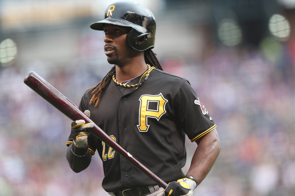 Photo - Pittsburgh Pirates' Andrew McCutchen reacts after avoiding an inside pitch by the Colorado Rockies in the first inning of a baseball game in Denver on Saturday, July 26, 2014. (AP Photo/David Zalubowski)