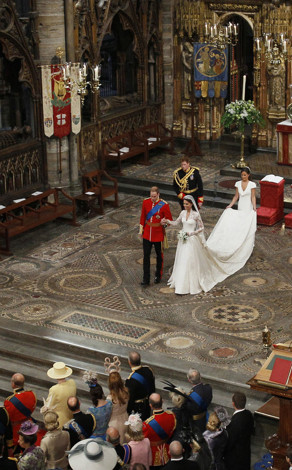 Photo - Britain's Prince William, center left, and his wife Kate, the Duchess of Cambridge, center right, best man Britain's Prince Harry, back left, and maid of honour Philippa Middleton, back right, accompany them following their wedding service at Westminster Abbey in London, Friday, April 29, 2011. (AP Photo/Kirsty Wigglesworth, Pool)