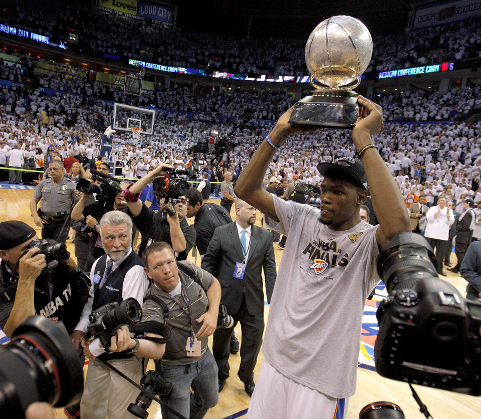 Oklahoma City\'s Kevin Durant holds the trophy after Game 6 of the Western Conference Finals between the Oklahoma City Thunder and the San Antonio Spurs in the NBA playoffs at the Chesapeake Energy Arena in Oklahoma City, Wednesday, June 6, 2012. Oklahoma City won 107-99. Photo by Bryan Terry, The Oklahoman