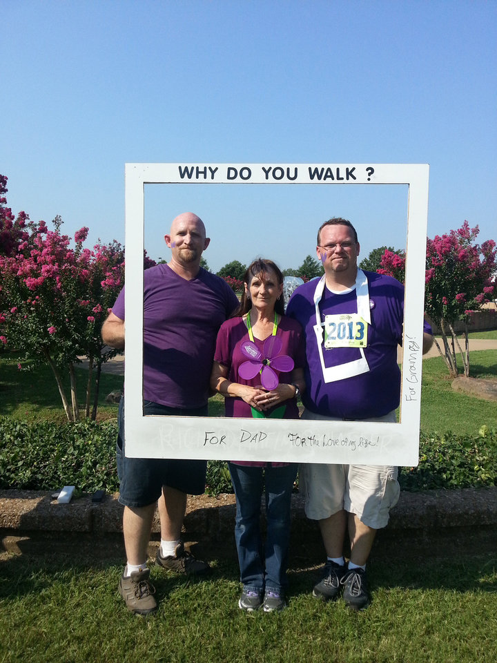 Photo - Brent Whitney stands with his brother Mike and their mother Sherry. Roger Whitney died at 55 after a struggle with early-onset Alzheimer's.