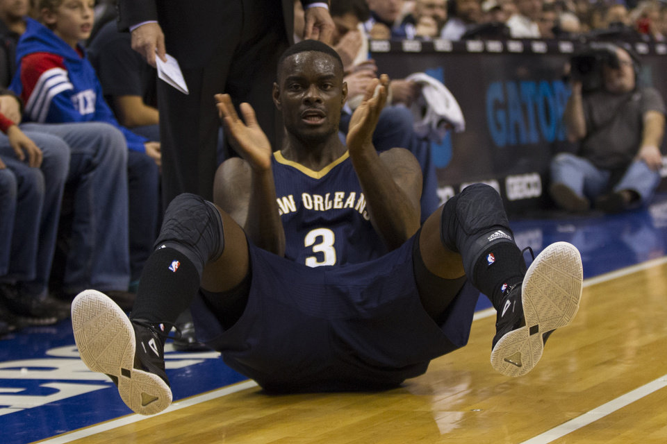 Photo - New Orleans Pelicans' Anthony Morrow reacts on the court during the first quarter of an NBA basketball game against the Philadelphia 76ers, Friday, Nov. 29, 2013, in Philadelphia.  The Pelicans win 121-105.  (AP Photo/Chris Szagola)