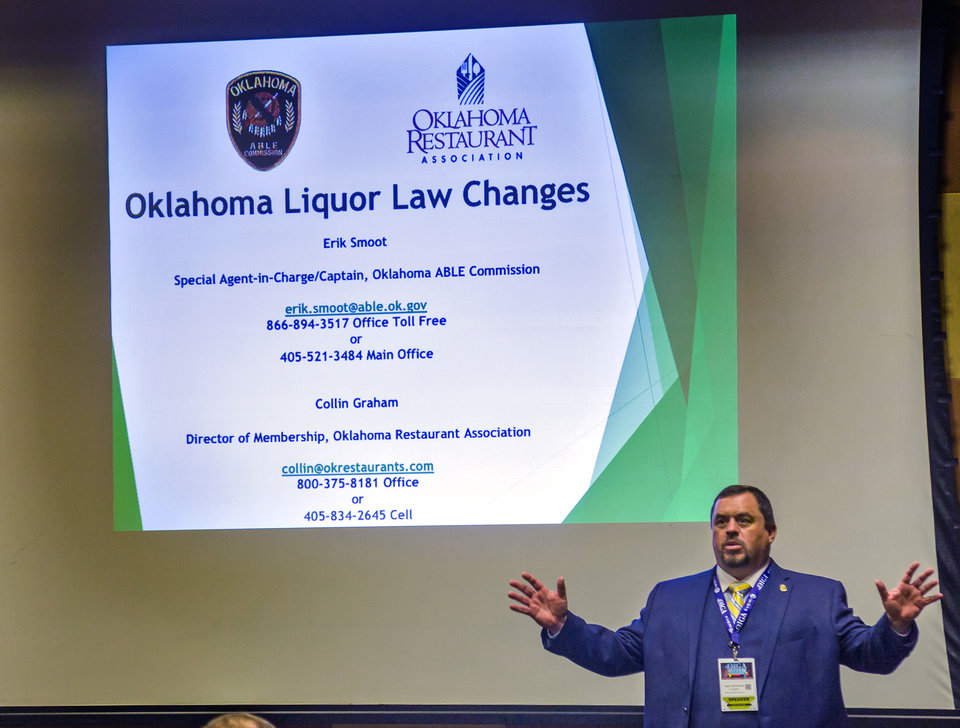 Photo - Oklahoma ABLE Commission's Capt. Erik Smoot speaks during the Oklahoma Indian Gaming Association conference seminar on the changes in Oklahoma liquor laws at the Cox Convention Center in Oklahoma City, Okla. on Wednesday, July 25, 2018.   Photo by Chris Landsberger, The Oklahoman