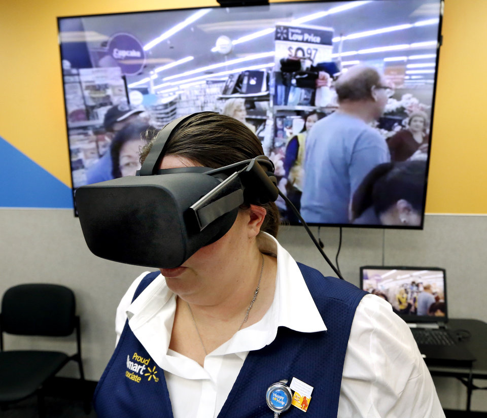Photo -  Other academy participants see on a screen what Smith sees in virtual reality during a Black Friday scenario.