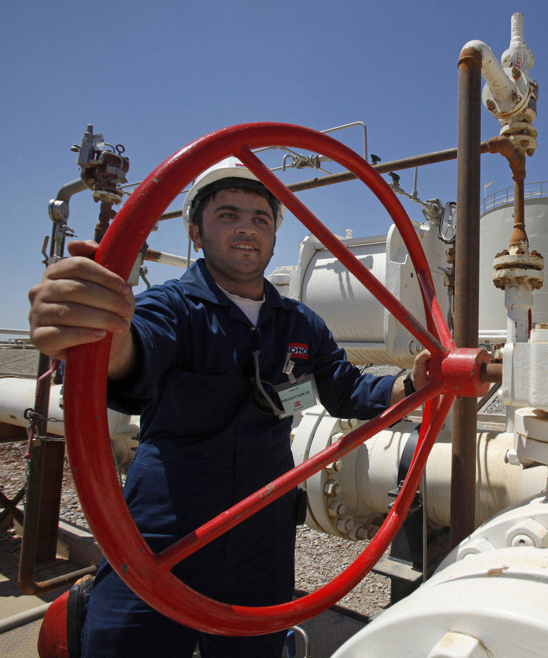 FILE - In this May 31, 2009 file photo, an employee works at the Tawke oil fields in the semiautonomous Kurdish region in northern Iraq. Iraq is threatening to seize oil exports made without its consent and sue companies dealing in what it sees as contraband crude just days after the country's self-rule Kurdish region began unilaterally exporting oil. (AP Photo/Hadi Mizban, File)