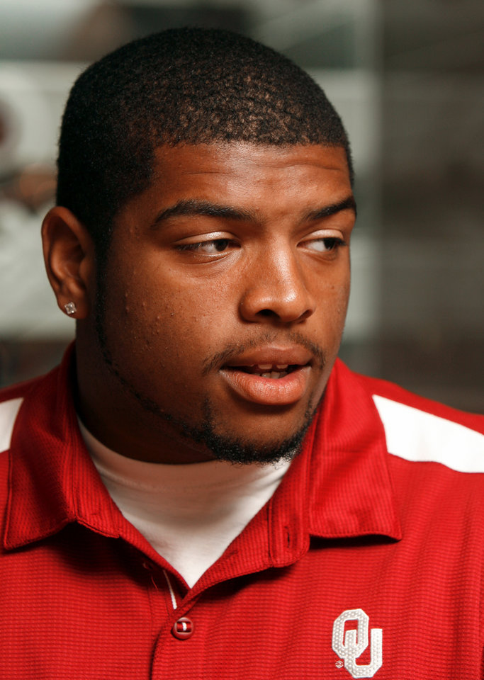 Photo - OU FOOTBALL: Trent Williams talks to the media during Bob Stoops' weekly media lunch and press conference at the University of Oklahoma in Norman, Oklahoma on Tuesday August 26, 2008.    BY STEVE SISNEY, THE OKLAHOMAN    ORG XMIT: KOD