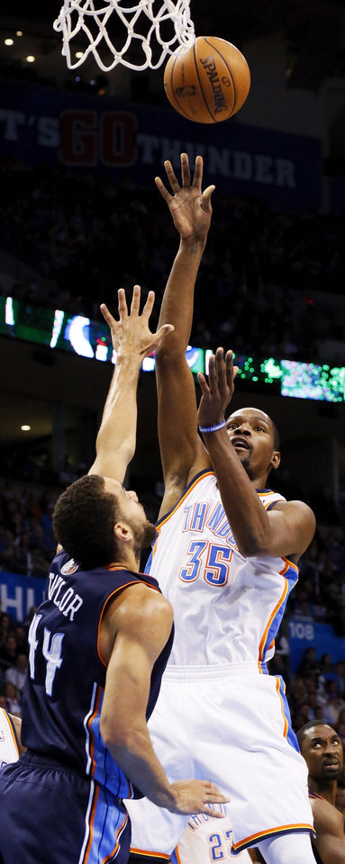 Oklahoma City's Kevin Durant (35) shoots over Charlotte's Jeffery Taylor (44) during an NBA basketball game between the Oklahoma City Thunder and Charlotte Bobcats at Chesapeake Energy Arena in Oklahoma City, Monday, Nov. 26, 2012.  Photo by Nate Billings , The Oklahoman