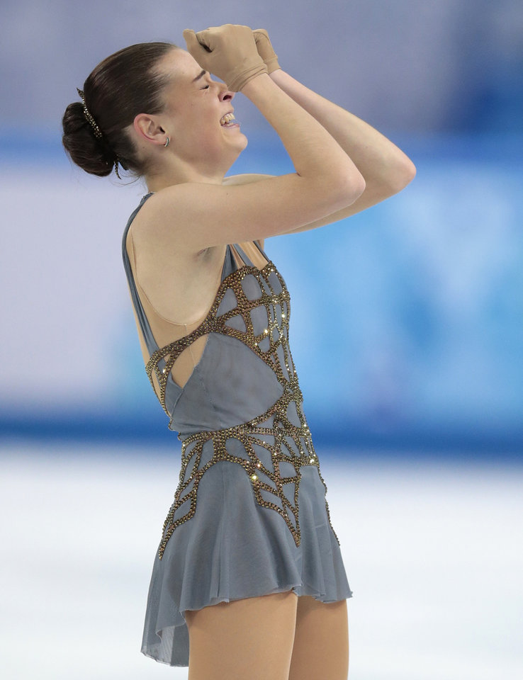 Photo - Adelina Sotnikova of Russia reacts after completing her routine in the women's free skate figure skating finals at the Iceberg Skating Palace during the 2014 Winter Olympics, Thursday, Feb. 20, 2014, in Sochi, Russia. (AP Photo/Ivan Sekretarev)
