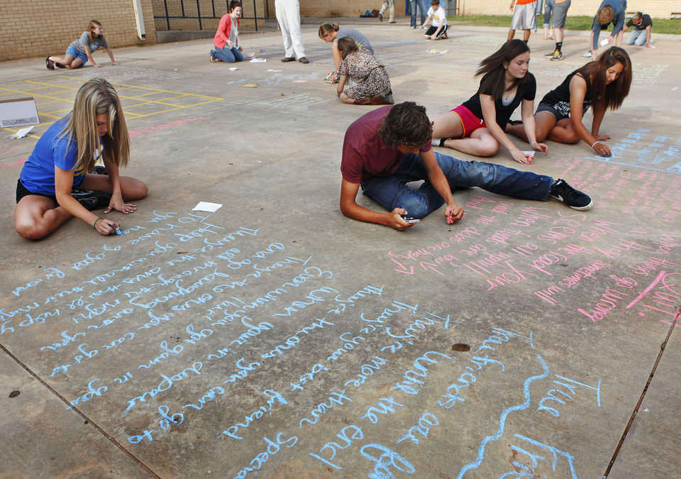 Students in Dustin Johnson�s freshman English classes at Choctaw High School observed National Poetry Month and Poem in Your Pocket Day on Thursday by writing poems in chalk.
