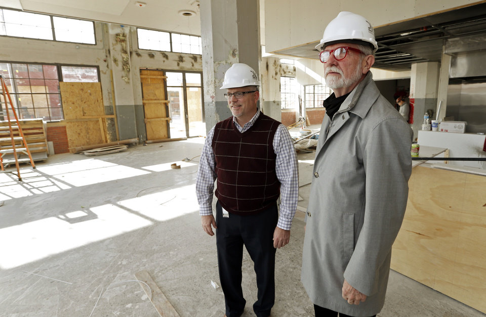 Photo -  Steve Wilson, right, founder of 21c Museum Hotels, and new general manager Matt Cowden survey progress in the future restaurant being built in the former home of Fred Jones Manufacturing. The hotel, restaurant, lounge and museum opens this summer. [Photo by Steve Sisney, The Oklahoman]