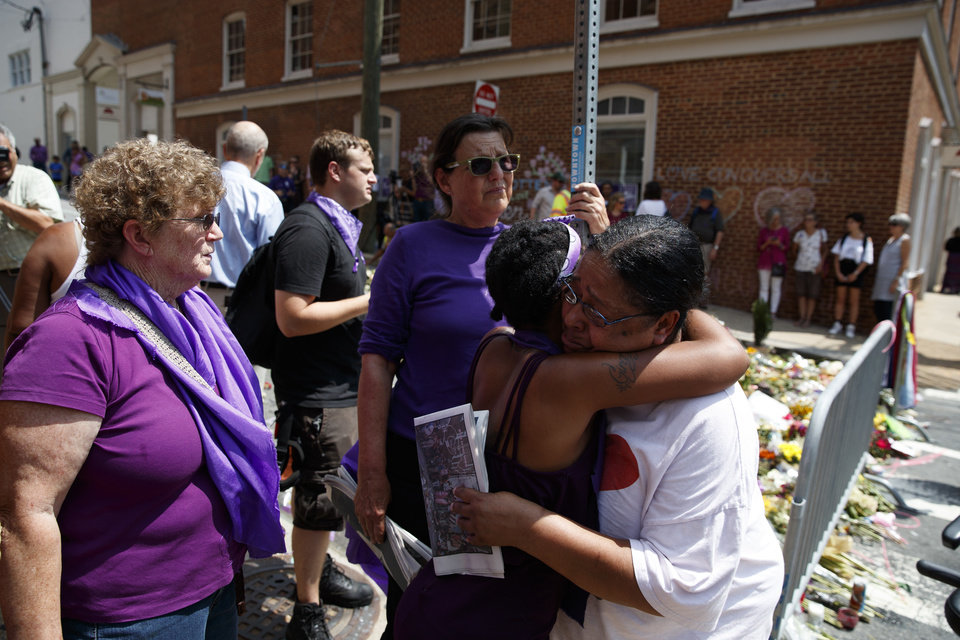 Photo - People gather near a memorial for Heather Heyer, who was killed during a white nationalist rally, after a service to honor her life, Wednesday, Aug. 16, 2017, in Charlottesville, Va. (AP Photo/Evan Vucci)