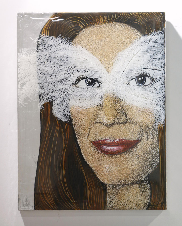 Photo - In this photo taken Wednesday, June 26, 2013,  is a masked composite portrait representing the women called liars when they accused former California Gov. Arnold Schwarzenegger of groping and other inappropriate behavior that is among the paintings of women with sexual ties to California Governors, in Sacramento, Calif.  The show, titled
