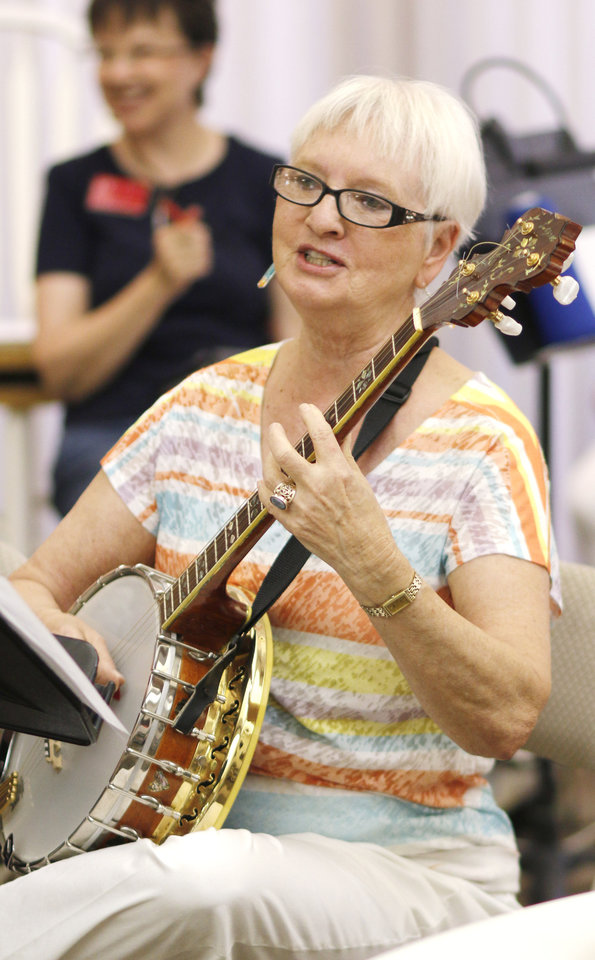 Photo -  Barbara Duer accompanies on the banjo at the monthly meeting of the Oklahoma City Accordion Club. Photo by Doug Hoke, The Oklahoman   DOUG HOKE