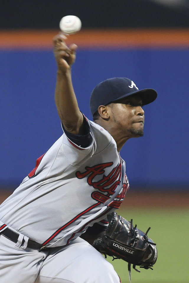 Photo - Atlanta Braves starting pitcher Julio Teheran throws in the first inning of a baseball game against the New York Mets, Wednesday, Aug. 27, 2014, in New York. (AP Photo/John Minchillo)