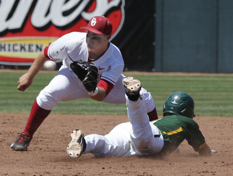 Photo - Oklahoma's Sheldon Neuse (22) gets the throw too late to tag Baylor's Brett Doe (1) as the University of Oklahoma Sooner (OU) baseball team plays the Baylor Bears in college baeball at L. Dale Mitchell Park on May 3, 2014 in Norman, Okla. Photo by Steve Sisney, The Oklahoman