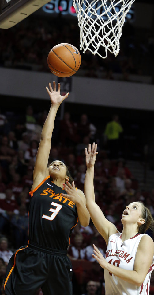 Photo - Oklahoma State's Tiffany Bias (3) shoots a lay up as Oklahoma's Morgan Hook (10) during the women's Bedlam basketball game between Oklahoma State University and Oklahoma at the Lloyd Noble Center in Norman, Okla., Sunday, Feb. 10, 2013.Photo by Sarah Phipps, The Oklahoman