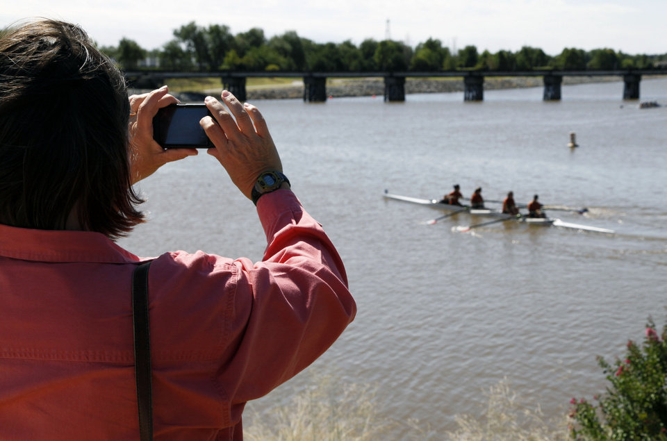 A parent takes photos of her daughter's rowing team during the Oklahoma Regatta Festival on the Oklahoma River in Oklahoma City, OK, Saturday, October 5, 2013,  Photo by Paul Hellstern, The Oklahoman