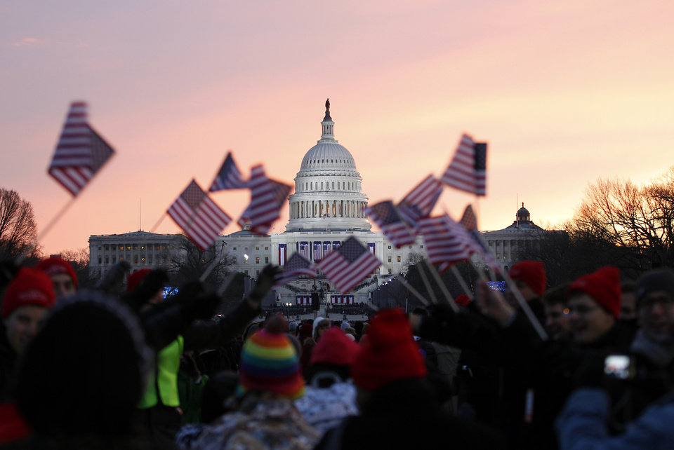 Photo - President Barack Obama supporters wave American flags on the National Mall in Washington, Monday, Jan. 21,  2013, prior to the start of President Barack Obama's ceremonial swearing-in ceremony during the 57th Presidential Inauguration. ( AP Photo/Jose Luis Magana)