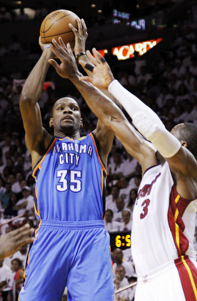 Oklahoma City\'s Kevin Durant (35) shoots against Miami\'s Dwyane Wade (3) during Game 3 of the NBA Finals between the Oklahoma City Thunder and the Miami Heat at American Airlines Arena, Sunday, June 17, 2012. Photo by Bryan Terry, The Oklahoman