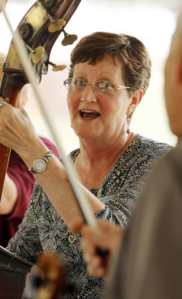 Jane Humphrey, Cogar, who plays with the band Cast Iron, sings and plays bass during a jam session at the Second Annual Bluegrass Festival on Saturday, Aug. 25, 2012, in Blanchard, Okla.  Photo by Steve Sisney, The Oklahoman