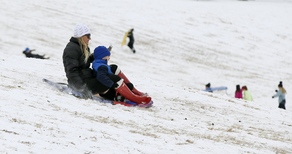 Photo - People sled down a hill at Douglas Park in Oklahoma City, Friday, Jan. 6, 2017. Photo by Nate Billings, The Oklahoman