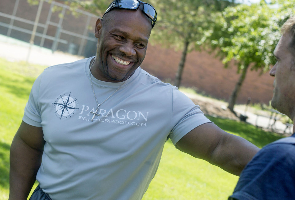 Photo -       Ron Williams, a nondenominational Christian pastor, leads an exercise group of Utah National Guard members at their headquarters on Thursday, Aug. 14, 2014. (Laura Seitz, Deseret News)