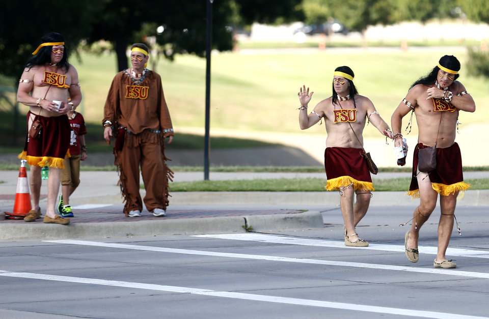 Photo - Florida State fans walk to the stadium before the college football game between Oklahoma State University (OSU) and Florida State University (FSU) at the AdvoCare Cowboys Classic at At&T Stadium in Arlington, Texas,  Saturday, Aug. 30, 2014. Photo by Sarah Phipps, The Oklahoman
