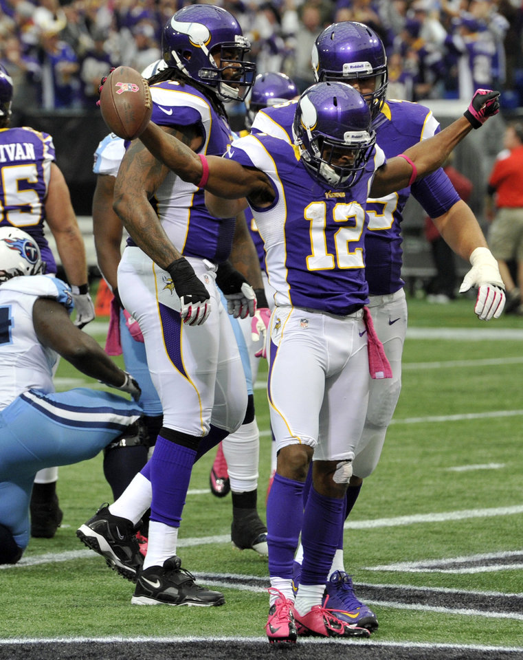 Photo -   Minnesota Vikings wide receiver Percy Harvin (12) celebrates after scoring a touchdown during the first half of an NFL football game against the Tennessee Titans, Sunday, Oct. 7, 2012, in Minneapolis. (AP Photo/Jim Mone)