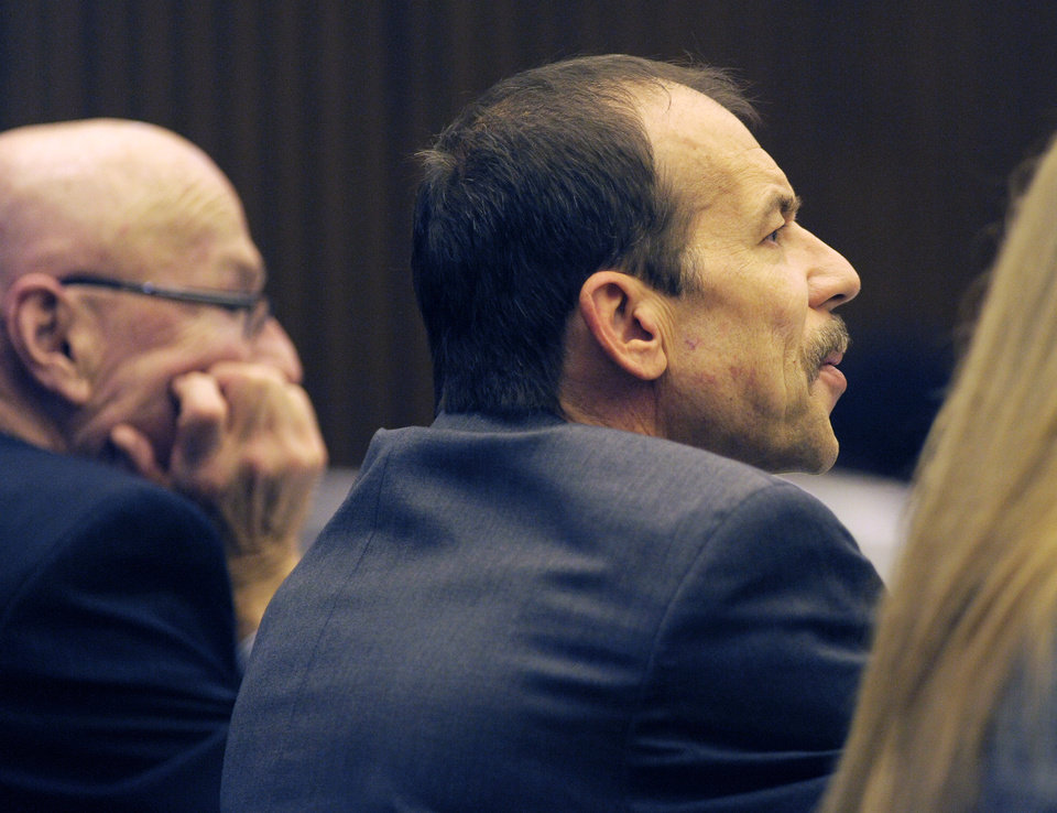 Photo - Theodore Wafer, right, listens during closing arguments of his trial Wednesday, Aug. 6, 2014 in Detroit. The case of Wafer, a suburban Detroit homeowner who opened his front door and blasted an unarmed woman on his porch, has gone to the jury. Wafer is charged with second-degree murder and manslaughter in the death of 19-year-old Renisha McBride. (AP Photo/Detroit News, Clarence Tabb Jr.)