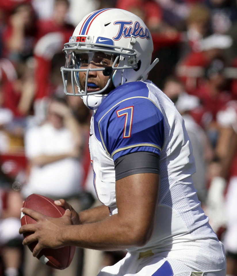Tulsa quarterback Cody Green looks for a receiver during the first half of an NCAA college football game against Arkansas in Fayetteville, Ark., Saturday, Nov. 3, 2012. (AP Photo/Danny Johnston)