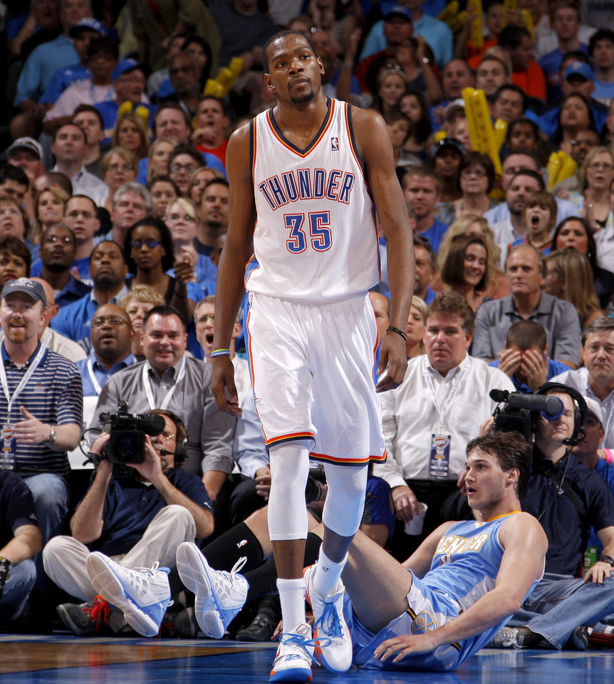 Photo - Oklahoma City's Kevin Durant (35) walks back after a foul was call on the Thunder as Denver's Danilo Gallinari (8) sits on the ground during the NBA basketball game between the Oklahoma City Thunder and the Denver Nuggets at Chesapeake Energy Arena in Oklahoma City, Wednesday, April 25, 2012. Oklahoma City lost 106-101. Photo by Bryan Terry, The Oklahoman