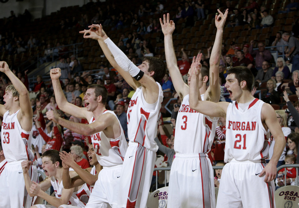 Photo - Forgan celebrates their win over Arnett in the championship game of the boys Class B state basketball tournament at the State Fair Arena in Oklahoma City,  Saturday, March 3, 2012. Photo by Sarah Phipps, The Oklahoman