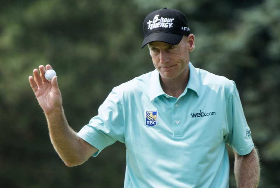 Photo - Jim Furyk salutes the crowd after putting out on the 9th hole during second round play at the Canadian Open golf championship Friday, July 25, 2014 in Montreal. (AP Photo/The Canadian Press, Paul Chiasson)