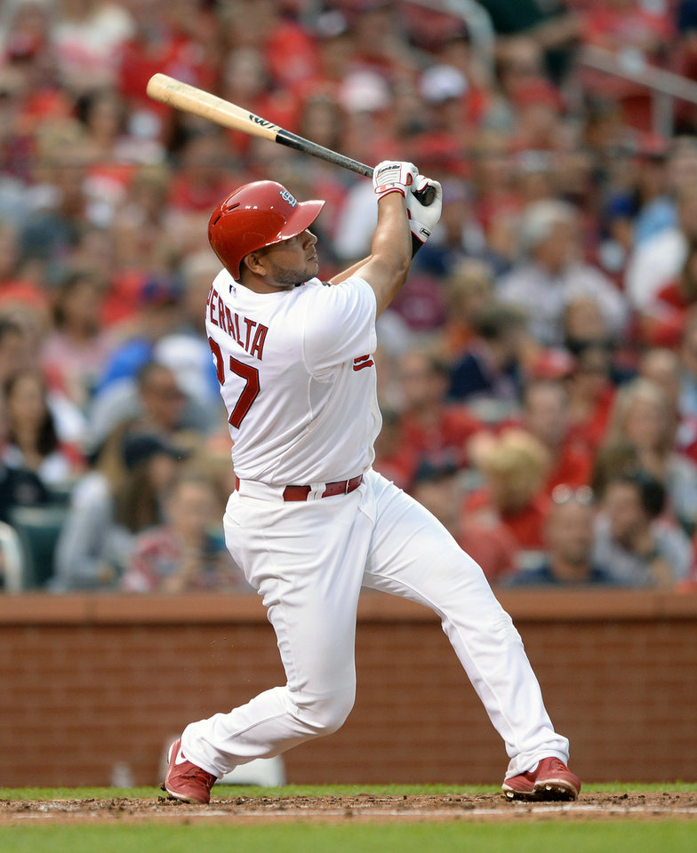 Photo - St. Louis Cardinals' Jhonny Peralta (27) follows through on his two-run home run against the San Diego Padres' in the second inning in a baseball game, Thursday, Aug. 14, 2014, at Busch Stadium in St. Louis. (AP Photo/Bill Boyce)
